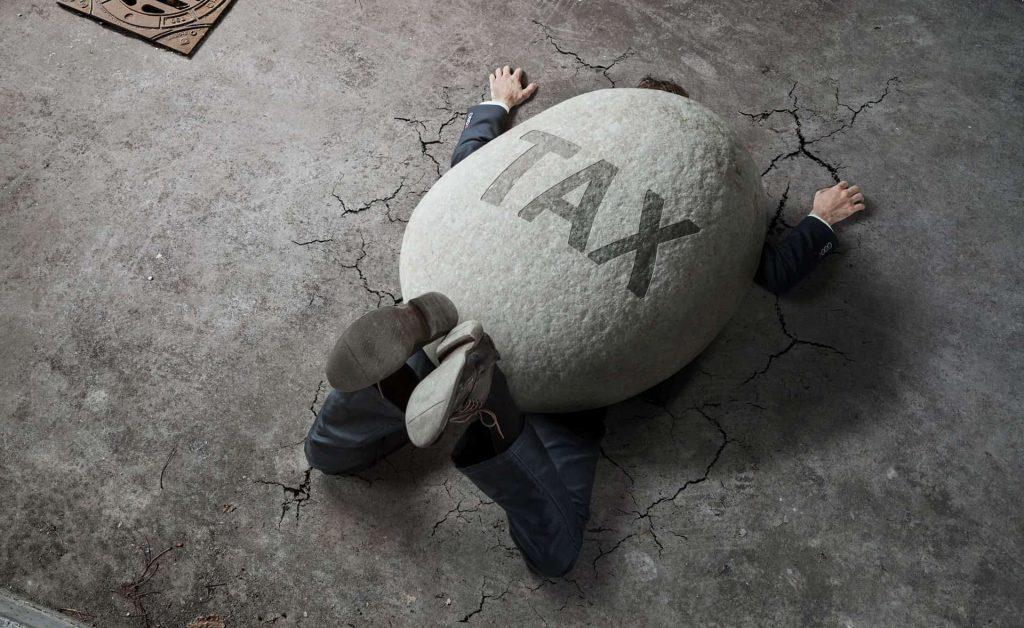 stone-weight-tax-crushes-man